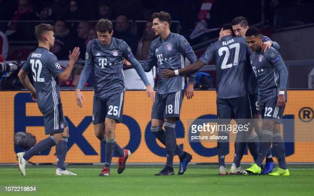 Soccer Champions League Ajax Amsterdam Bayern Munich Group stage Group E 6 th matchday in the in the Johann Cruyff ArenA The players of Munich cheer...