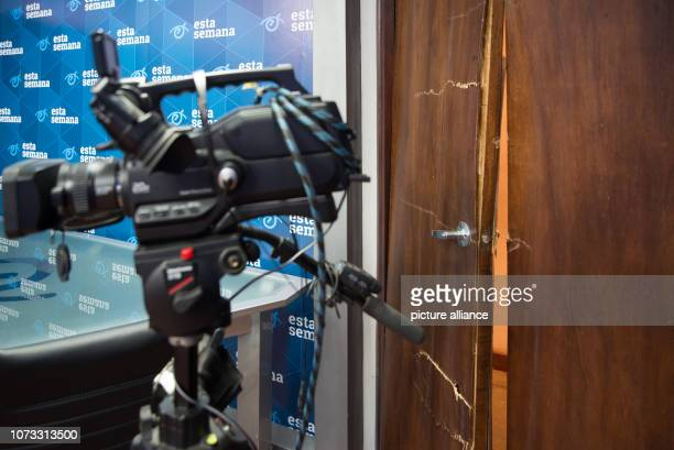 """December 2018, Nicaragua, Managua: Broken door of an office after policemen entered the facility of the magazine """"Confidencial"""" and the TV shows..."""