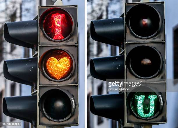 "December 2018, North Rhine-Westphalia, Dortmund: KOMBO - A traffic light in Dortmund shows ""I love you"". The signal system was probably sprayed with..."