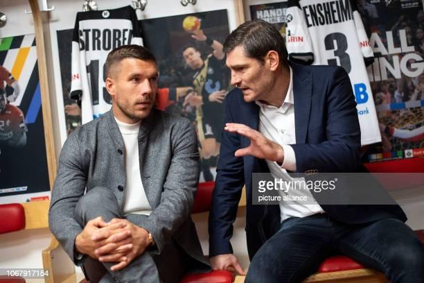 03 December 2018 North RhineWestphalia Köln Lukas Podolski Football World Champion and Ambassador of the 2019 Handball World Cup and Henning Fritz...