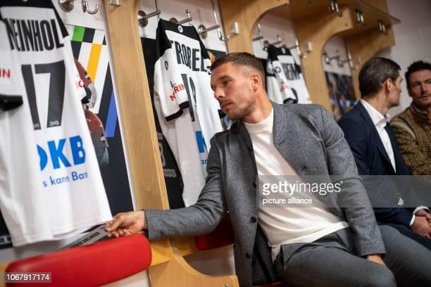 03 December 2018 North RhineWestphalia Köln Lukas Podolski soccer world champion and ambassador of the 2019 World Handball Championship sits in the...