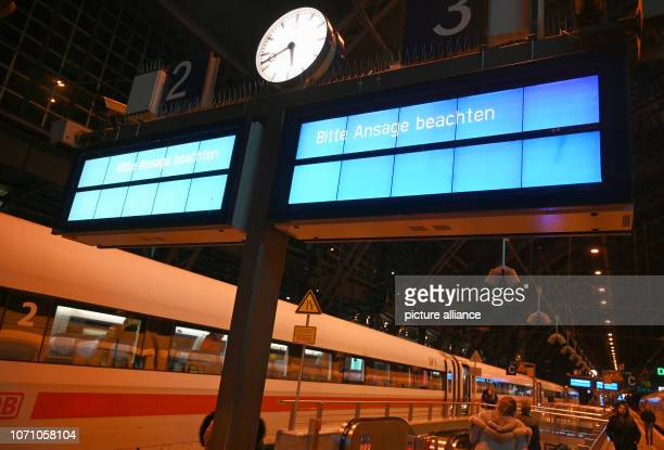 10 December 2018 North RhineWestphalia Köln Trains are standing at a platform in the main station while information boards ask you to follow the...