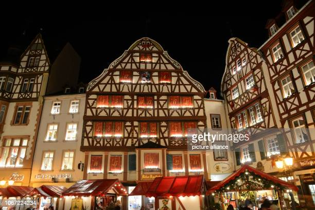 01 December 2018 RhinelandPalatinate BernkastelKues The first window of the huge Advent calendar is open On the halftimbered house a new one of the...