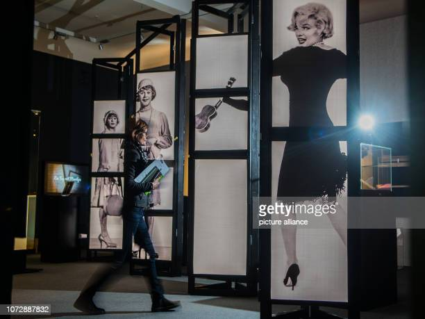 11 December 2018 RhinelandPalatinate Speyer A museum employee approaches an oversized portrait of Marilyn Monroe from the film 'Some Like It Hot' The...
