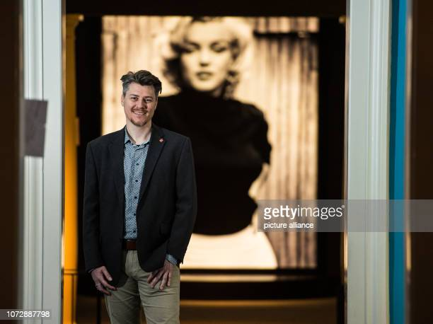 11 December 2018 RhinelandPalatinate Speyer Lars Börner curator stands in front of an oversized portrait of Marilyn Monroe The 'Historical Museum of...