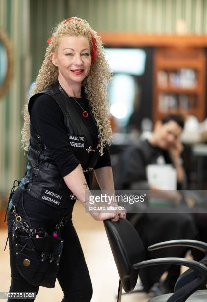 Hairdresser Claudia MihalyAnastasio is standing in her leather cowl in the hairdresser's salon She is engaged as Barber Angel a hairdresser's angel...