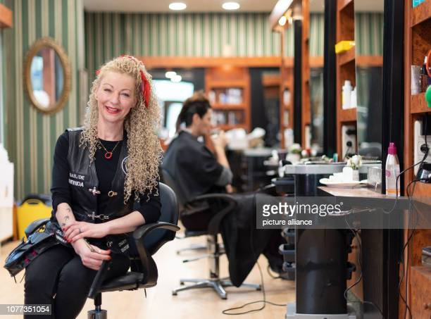 Hairdresser Claudia MihalyAnastasio sits in her leather robe in the hairdresser's salon She is engaged as Barber Angel a hairdresser's angel who cuts...