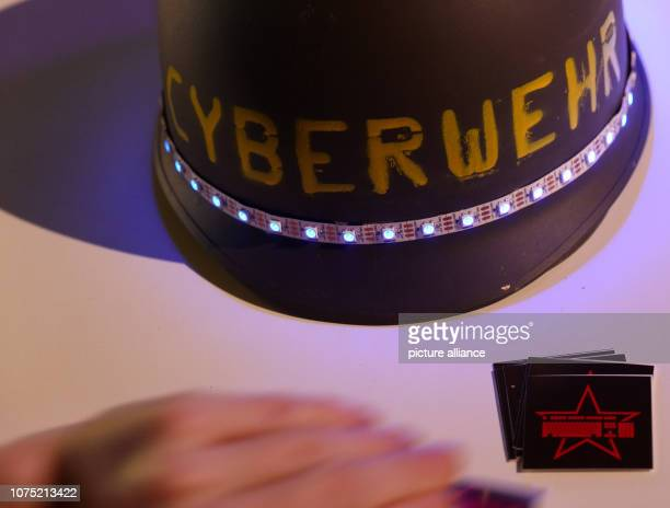 A steel helmet with the inscription Cyberwehr and LED light strips taken at the 35th Chaos Communication Congress at the fair The Chaos Computer Club...