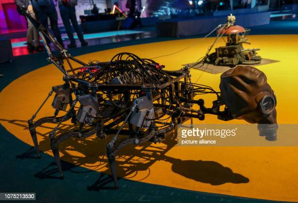 An insectshaped robot runs in a circle at the 35th Chaos Communication Congress at the trade fair The Chaos Computer Club invites you to its annual...