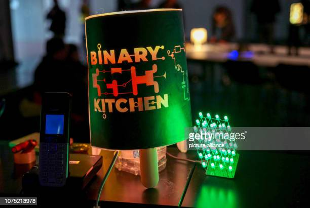 """December 2018, Saxony, Leipzig: """"Binary Kitchen"""" stands on a lamp of the stand of the same name at the 35th Chaos Communication Congress at the trade..."""