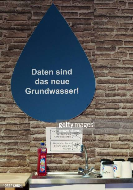 The lettering Daten sind das neue Grundwasser stands in a stylized drop of water at the Wiki stand at the 35th Chaos Communication Congress at the...