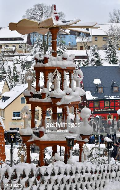 A Christmas pyramid covered with snow stands in the centre of the toy village Seiffen During Advent Seiffen is considered a tourist magnet and...