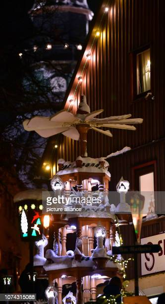 A Christmas pyramid covered with snow turns in the centre of the toy village Seiffen During Advent Seiffen is considered a tourist magnet and...