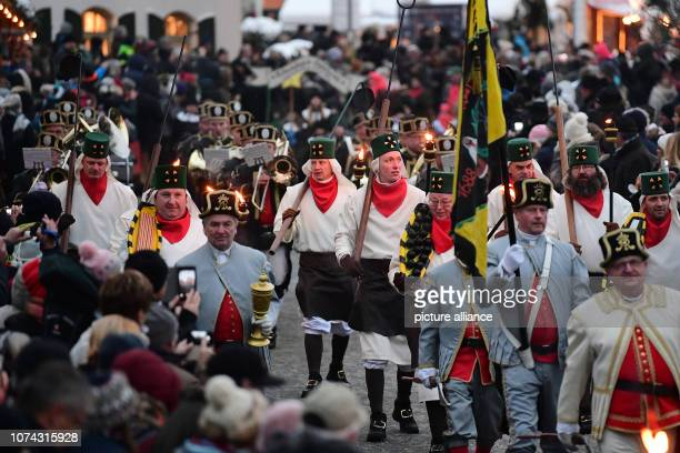 Miners in the festive Habit parade through the toy village of Seiffen for the Great Mountain Parade The mountain parades are typical for the...