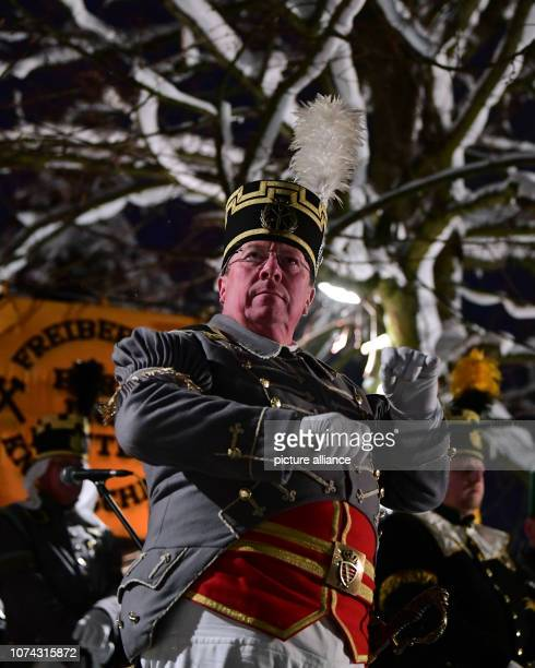 Mountain music master Jens Kaltofen conducts a march to the final concert of the Great Mountain Parade in the toy village Seiffen The mountain...