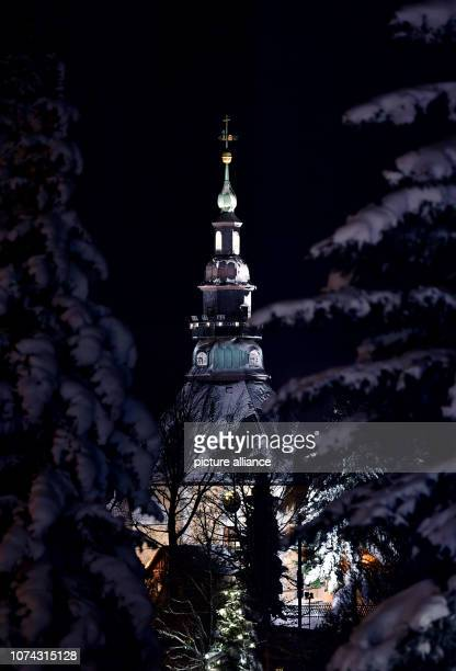 Snow covers the toy village of Seiffen with its striking mountain church The church in its octagonal shape was built according to a design by master...