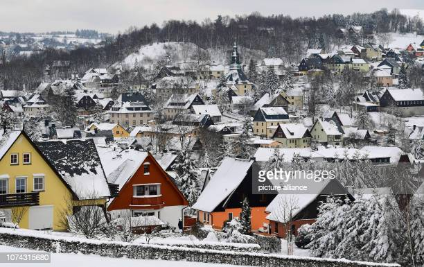 Snow covers the toy village of Seiffen with its striking mountain church The octagonal church was built according to a design by master carpenter...