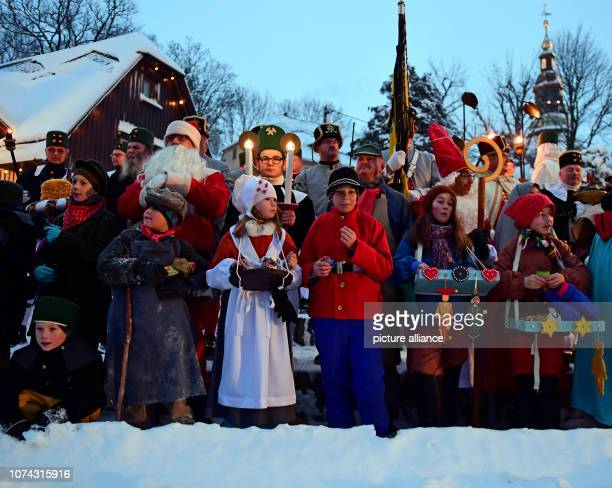 The children's costume group 'Living Toys' decorates the Great Mountain Parade in the toy village of Seiffen The mountain parades are typical for the...
