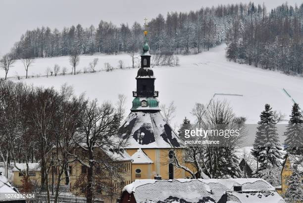 The mountain church in the toy village Seiffen is covered with snow The octagonal church was built according to a design by master carpenter...