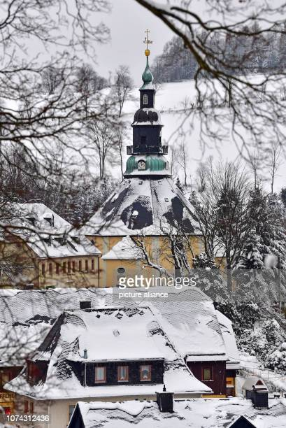 The roofs and the mountain church in the toy village Seiffen are covered with snow The octagonal church was built according to a design by master...