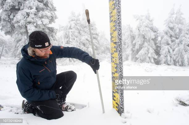 Rene Sosna weather service technician of the weather station of the German Weather Service on the Brocken measures the snow depth at a snow level On...
