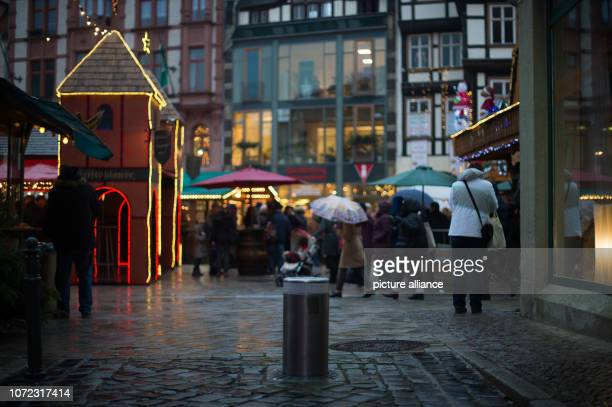 12 December 2018 SaxonyAnhalt Quedlinburg A permanently installed retractable bollard can be seen in an alley leading to the Christmas market The...