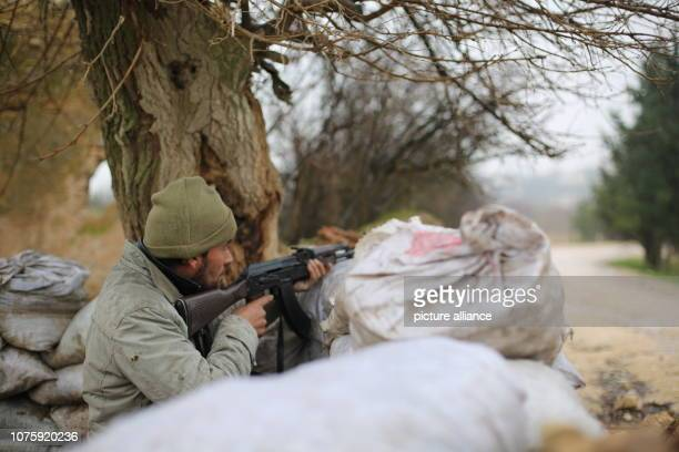 A member of Turkeybacked Syrian militia aims his weapon near the Northern Syrian city of Manbij which is mainly carried out by Kurdish forces Photo...