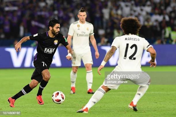 22 December 2018 United Arab Emirates Abu Dhabi Real Madrid's Marcelo and Al Ain's Hussein El Shahat battle for the ball during the FIFA Club World...