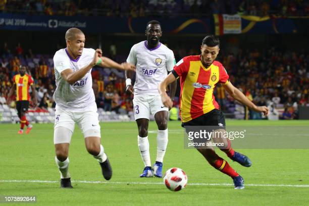 15 December 2018 United Arab Emirates Al Ain Al Ain's Mohamed Ismail Ahmed Ismail and Ahmed Barman in action with Tunis' Anice Badri during the FIFA...