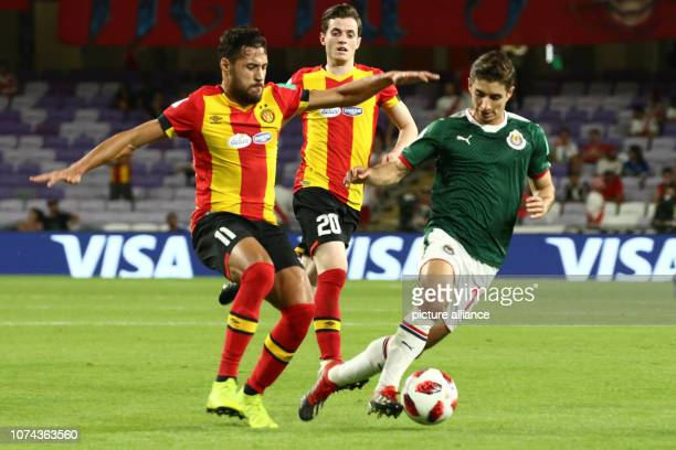 18 December 2018 United Arab Emirates Al Ain Guadalajara's Isaac Brizuela and Tunis' Mohamed Youcef Belaili battle for the ball during the FIFA Club...