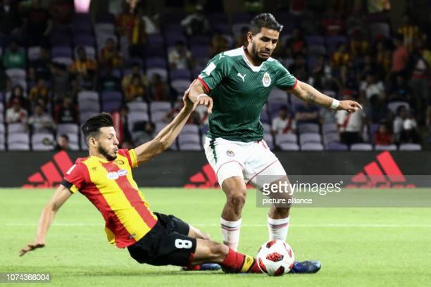 18 December 2018 United Arab Emirates Al Ain Tunis' Anice Badri and Guadalajara's Miguel Ponce battle for the ball during the FIFA Club World Cup...