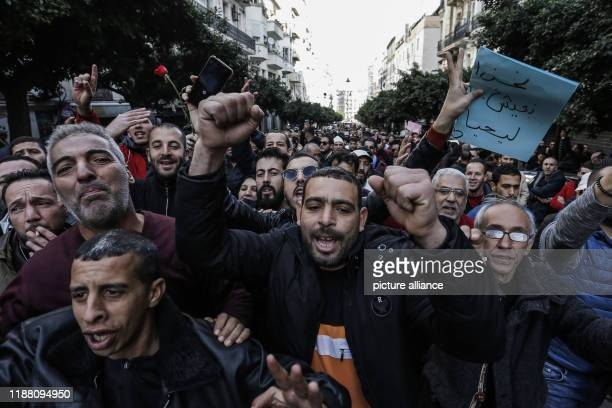 Algerian demonstrators shout slogans during a demonstration against the ongoing presidential elections Photo Farouk Batiche/dpa