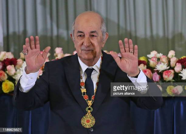 Algerian President Abdelmadjid Tebboune waves after his swearingin ceremony Photo Farouk Batiche/dpa