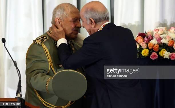 Algerian President Abdelmadjid Tebboune embraces Algerian Army Chief of Staff Ahmed Gaid Salah during Tebboune's swearingin ceremony Photo Farouk...