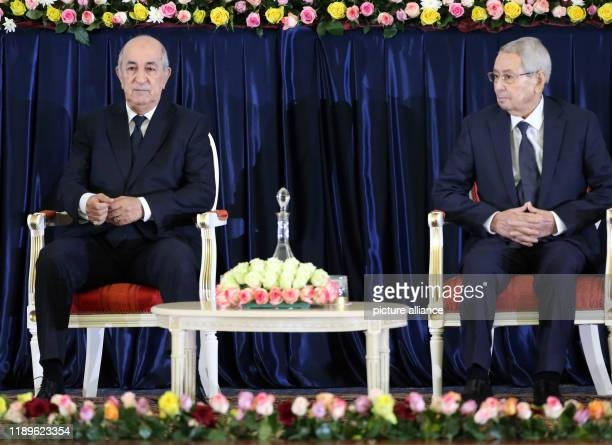 Algerian Presidentelect Abdelmadjid Tebboune sits next to outgoing Interim President Abdelkader Bensalah during the swearingin ceremony Photo Farouk...