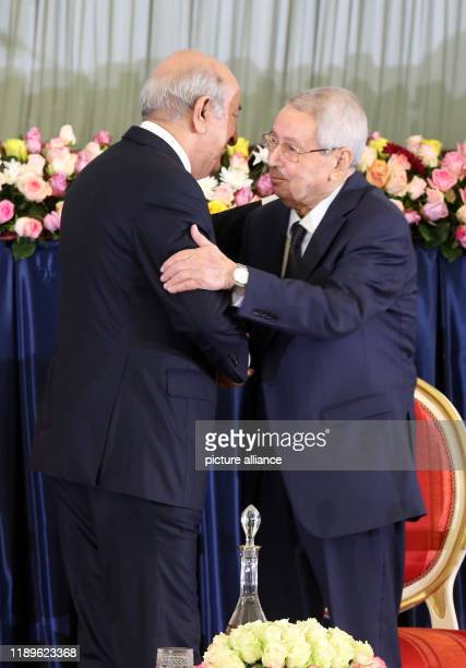 Algerian Presidentelect Abdelmadjid Tebboune embraces outgoing Interim President Abdelkader Bensalah during the swearingin ceremony Photo Farouk...