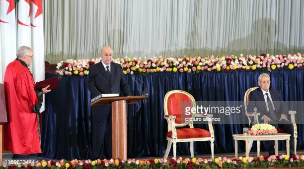 Algerian Presidentelect Abdelmadjid Tebboune takes the oath during the swearingin ceremony in the presence of outgoing Interim President Abdelkader...