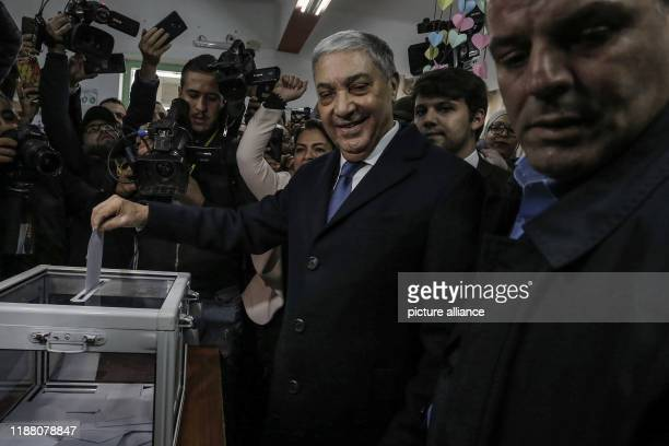 December 2019, Algeria, Algiers: Ali Benflis , Algerian presidential candidate and head of Talaie El-Hurriyet party, casts his vote at a polling...
