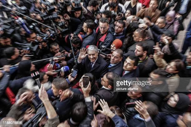 December 2019, Algeria, Algiers: Ali Benflis , Algerian presidential candidate and head of Talaie El-Hurriyet party, arrives to cast his vote at a...