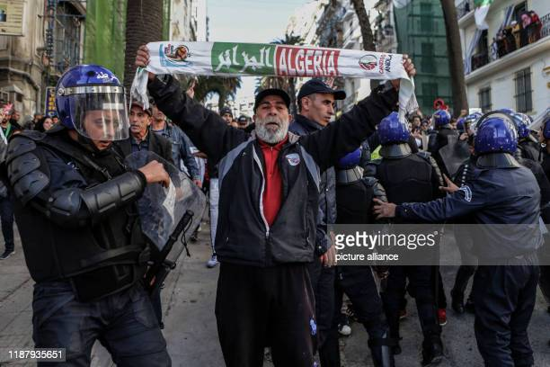 An Algerian protester holds a placard during an antigovernment demonstration to protest against a presidential election scheduled for Thursday Photo...