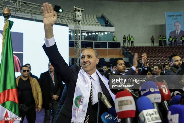 Azzedine Mihoubi presidential candidate and Secretary General of the Democratic National Rally waves to his supporters during an election campaign...