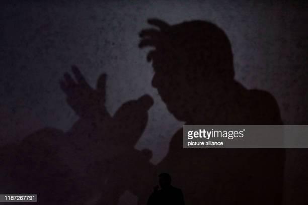 December 2019, Algeria, Algiers: The shadow of Algerian presidential candidate and head of Talaie El-Hurriyet party, Ali Benflis, is seen as he...