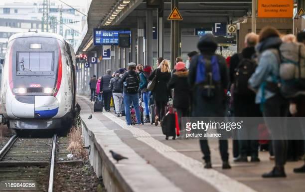 20 December 2019 BadenWuerttemberg Stuttgart At the beginning of the Christmas holiday season passengers wait at Stuttgart Central Station for a TGV...