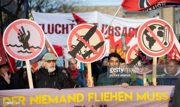 December 2019, Baden-Wuerttemberg, Stuttgart: Participants will hold a demonstration of climate and peace activists and supporters of refugee...
