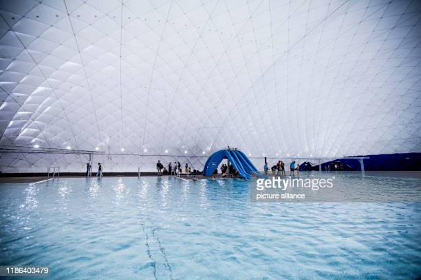 December 2019, Berlin: Guests take part in the official opening of the swimming pool air dome. With a floor area of 60 x 68 metres, the indoor...