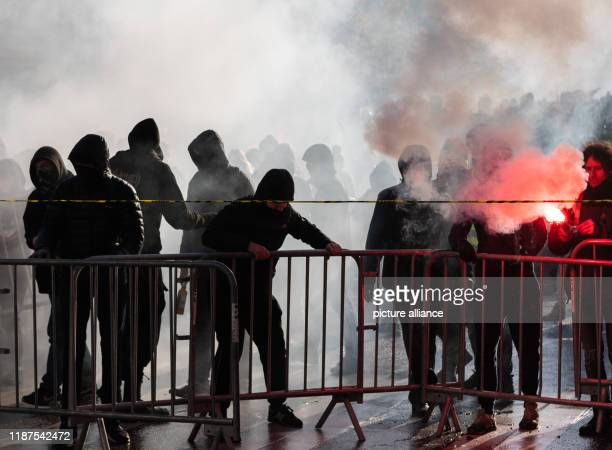 December 2019, France , Lyon: Demonstrators build a barricade during a demonstration in the context of strikes and protests against the pension...