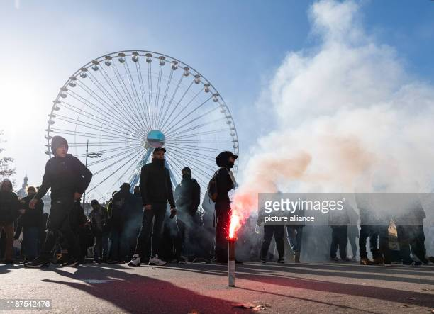 December 2019, France , Lyon: Pyrotechnics burns during a demonstration in the context of strikes and protests against the pension reform in France...