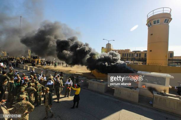 December 2019, Iraq, Baghdad: Iraqi Shiite militia supporters burn property during a demonstration inside the US embassy compound in Baghdad. Iraqi...