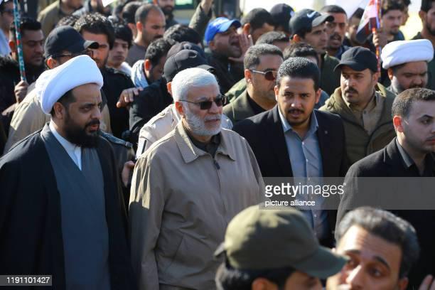 December 2019, Iraq, Baghdad: Qais al-Khazali , leader of the militant group Asaib Ahl al-Haq, and Abu Mahdi al-Muhandis, a commander in the Popular...