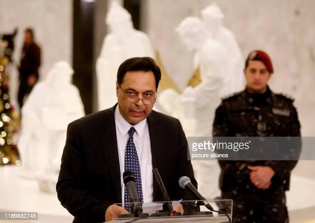 December 2019, Lebanon, Beirut: Lebanese newly-designated Prime Minister, Hassan Diab speaks to media following his meeting with Lebanese President...